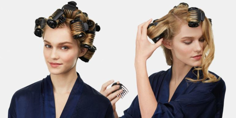 Woman using hot rollers.